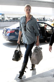 Charlize Theron kept her airport style classic in a versatile chambray button-up.