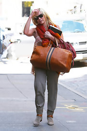 Chelsea Handler was spotted in NYC carrying a large tan leather duffel embossed with her initials.
