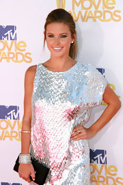 Audrina Patridge showed off her sequin dress which she paired with sparkling bangle bracelets.
