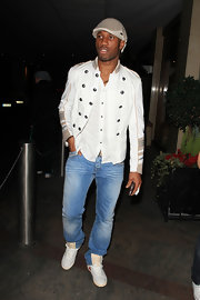 Didier Drogba paired washed-out jeans with a white military jacket for a night out clubbing.