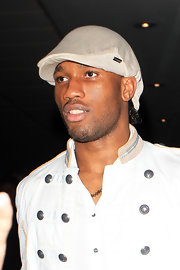 Didier Drogba topped off his clubbing ensemble with a beige newsboy cap.