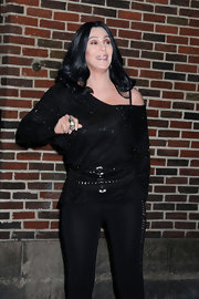 Cher layers on the studded belts with this sequin top.