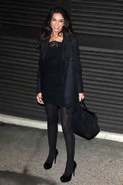 Terri Seymour looked classically chic in a pair of black patent platforms. She paired the heels with black tights, an LBD and matching trench for an ultra-sleek look.