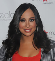 Cheryl Burke wore rich, smoky shades of shadow to intensify her eyes at the launch of Ideology active wear.