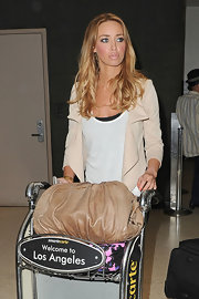 Lauren Pope walked through LAX wearing her golden locks in long loose waves.