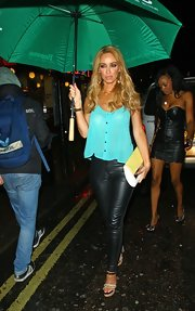 Lauren escaped the rain outside DSTRKT nightclub in some leather trousers and a lovely sheer blue sleeveless blouse.