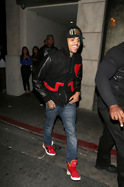 Chris Brown sported a pair of statement kicks in bright red as he was photographed outside the Playhouse club.