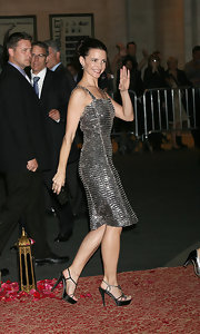 Kristin rocked a glitzy evening dress with satin, strappy, platform sandals.