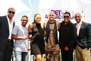 Chris Brown accentuated his outfit with a shiny leather vest as he did photo ops on stage.