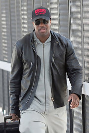 A classic leather jacket was Chris Tucker's travel look of choice.