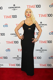 Xtina rocked this fitted black column-style dress with a triangular cutout at the bust for her red carpet look at the Time 100 Gala.