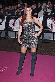 Imogen looks sassy in a strapless lace mini dress and over-the-knee boots for the premiere of 'Burlesque.'