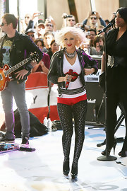 The popstar reinvented herself once again. Christina copleted her glam-rock, onstage ensemble with metallic hotpants.