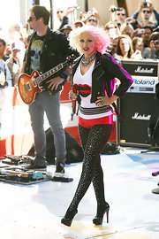 Christina hit the stage sporting metallic hotpants with crystal embellished tights and sky-high platform pumps.