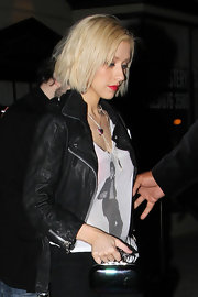 "The singer looked hot in bright red lipstick, a Michael Jackson tee and a black ""Cropped Moto Leather Jacket""."