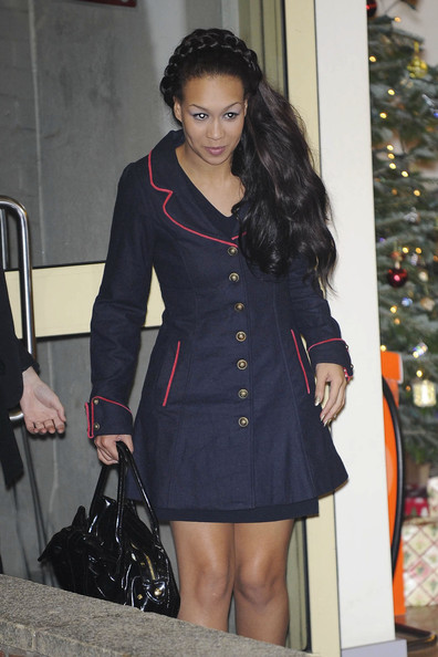Rebecca Ferguson looked very stylish in a military-inspired navy coat with red piping and gold buttons as she left the Fountain Studios.