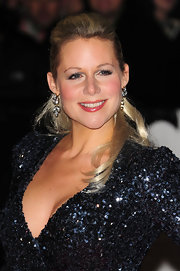 Abi Titmuss highlighted her sequined dress with decorative diamond earrings.