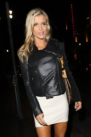 Joanna finished off her white mini skirt with a hard-hitting leather jacket.