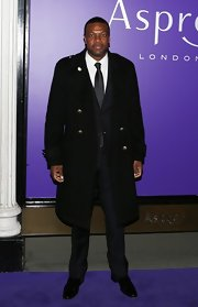 Chris Tucker donned a black trench coat to a pre-BAFTA party in London.