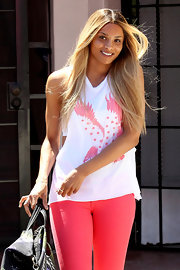 Ciara keeps her soft tresses long with an ombre tint.