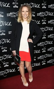Kimberly Walsh bundled up on the red carpet with this classic black wool coat.