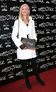 Joely Richardson chose a classic white wool coat to top off her sleek and sophisticated red carpet look.