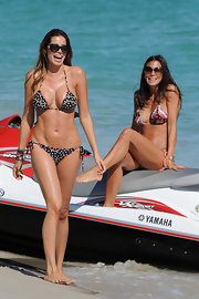 Aida Yespica looked titillating in a tiny polka-dot string bikini while jet-skiing in South Beach.