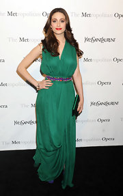 Emmy Rossum accented her jade green gown with a matching glam satin clutch.