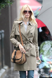Claudia donned a classic trench with a suede shoulder bag while out and about in London.