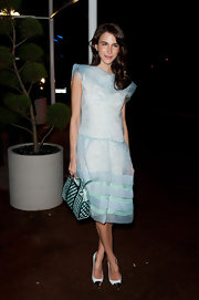 Caroline paired her baby blue cocktail dress with cap-toe pumps.
