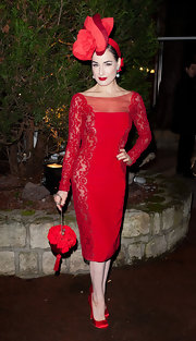 Dita Von Teese went full on floral, matching her decorative hat to a rosette-adorned clutch.