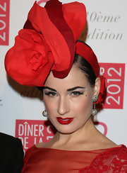 Dita Von Teese knows how to make a statement. Try this red blossoming head piece at the Sidaction Gala Dinner.