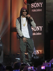 T.I. wore this zip-up jacket with leather sleeves while performing in LA for a casual stage-look.