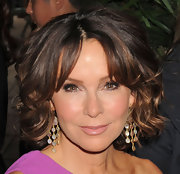 Jennifer Grey was flawlessly coiffed in a short curly style with center-parted bangs when she attended the 'Avengers' premiere.