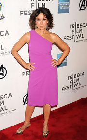 Jennifer Grey looked foxy at the premiere of 'The Avengers' in a purple one-shoulder dress and gold platform sandals.