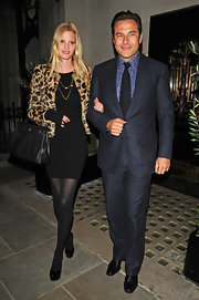 Lara is uber-chic in a leopard print evening jacket.