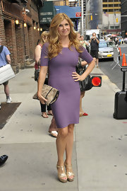 Connie Britton signed autographs outside 'The Late Show with David Letterman' in sultry gold metallic T-strap heels. The platforms added shine to her lavender bandage dress.