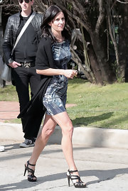 Courtney Cox paired her printed dress with sexy ankle strap sandals.