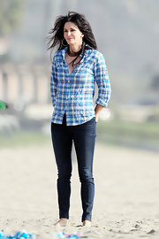 Courteney traded in her swimsuit for a figure-hugging pair of jeans while filming 'Cougar Town' on an LA beach.