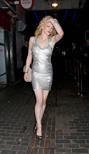 Courtney Love went out to a night club in London wearing a silver bandage dress and black heels. She painted her lips red for a dramatic effect.