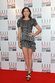 Minnie Driver's legs looked a mile long at the Elle Style Awards in black satin crisscross sandals.