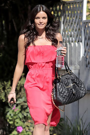 Courtney wore her dark tresses in tousled curls.