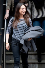Mila Kunus added a touch of nautical style to her outfit with a gray striped top.