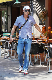Cristiano paired his blue plaid shirt with a white fitted baseball cap.