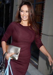 Tia Carrere sported a stylish get-up, consisting of a maroon dress and a metallic gold clutch, when she had her nails done in Beverly Hills.