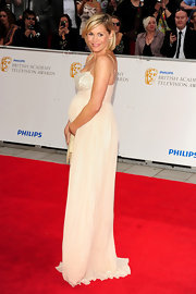Cradling her growing bump at the 2011 BAFTAS in London, Jenni Falconer looked divine in her embellished floor length gown.