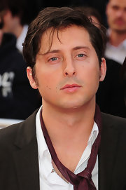Carl Barat looked dark and mysterious with his hair in messy side-swept waves.