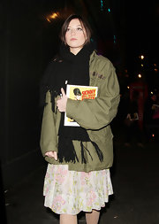Daisy Lowe opted for an oversized army jacket for her cool and hip evening ensemble.