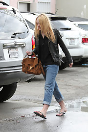 Dakota Fanning opted for an edgy look with this black leather jacket paired with a baggy shirt and jeans.