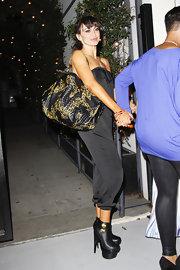 Karina Smirnoff kept her street style exotic in Hollywood with a black quilted tote with gold embroidery.